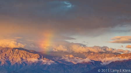 Image of a rainbow at sunrise over Death Valley