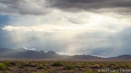 Image of rain and crepuscular rays over Nevada desert