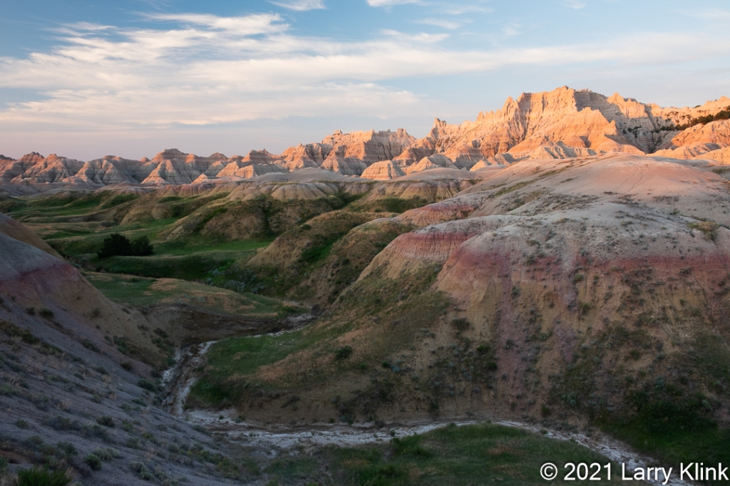 Colorful, eroded valley at sunrise.