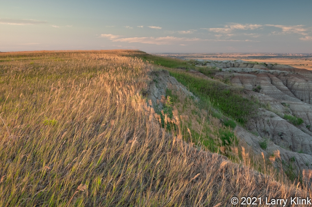 Grassy edge of prarie transitioning to eroded valley.